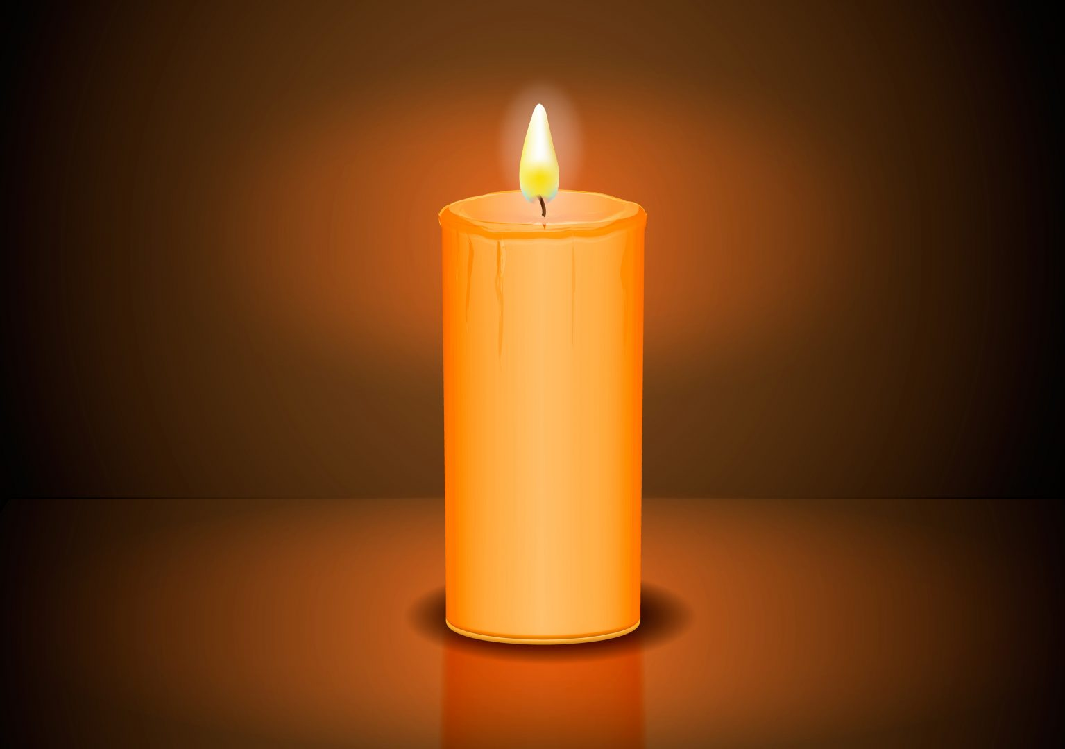 closeup of burning candle in dark