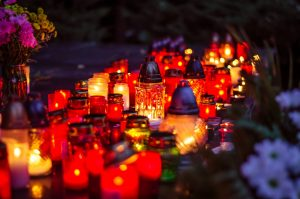 Colorful burning candles during All Saints Day at the cemetery