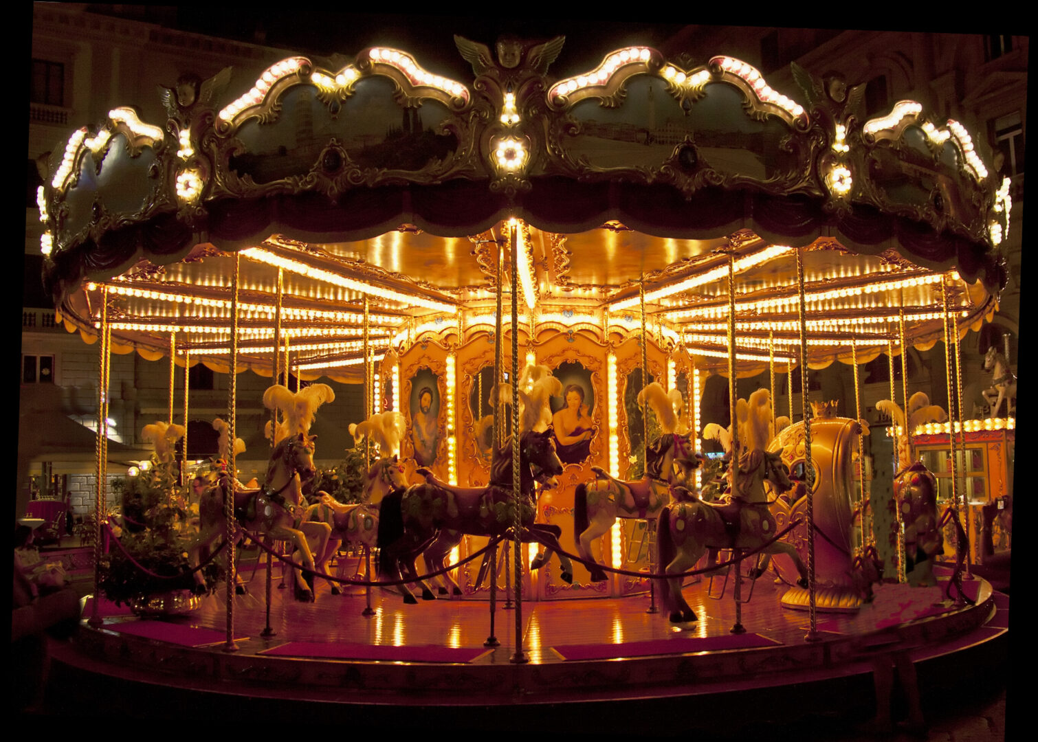 lit carousel at night