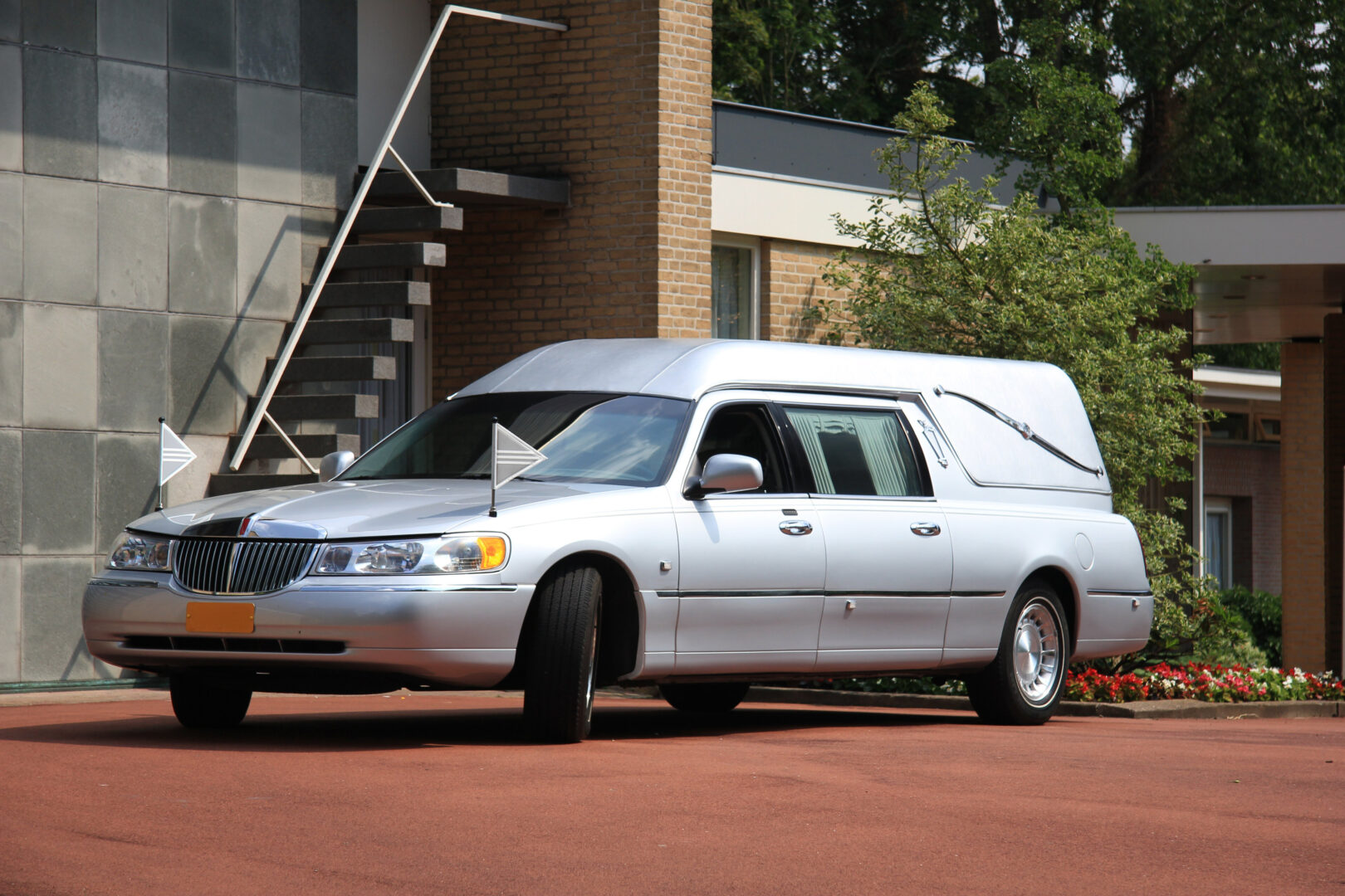 parked white funeral hearse