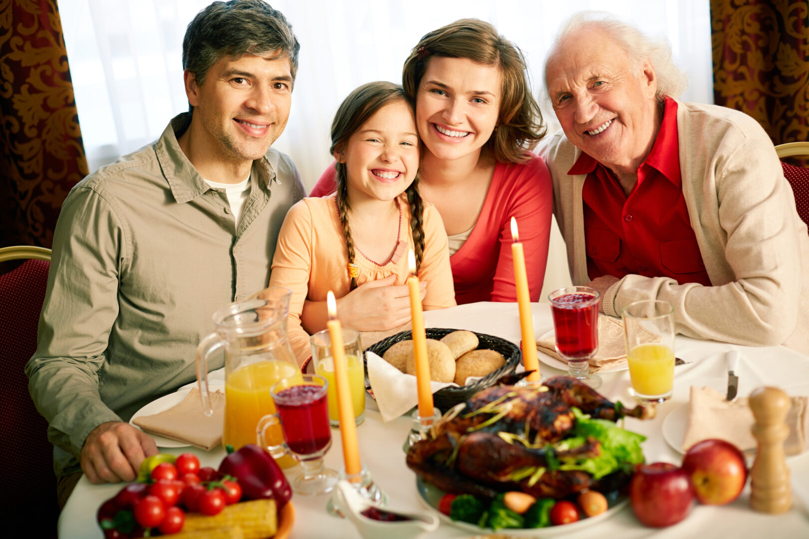 family with grandpa around table at Thanksgiving dinner