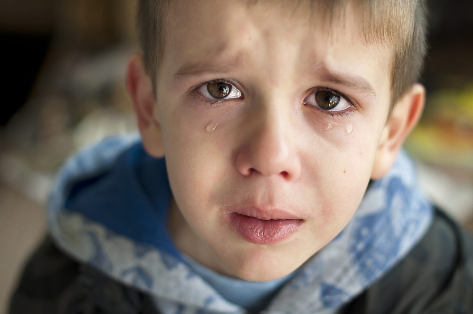 male child crying tears rolling from eyes down cheeks